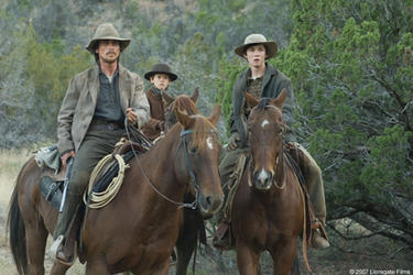 Dan Evans (Christian Bale) and his sons Mark Evans (Ben Petry) and William Evans (Logan Lerman) in &quot;3:10 to Yuma.&quot;